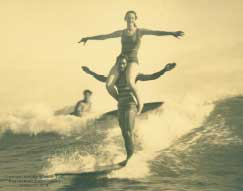 Three persons surfing
