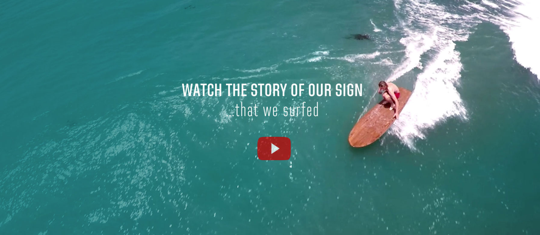Watch the story of our sign that we surfed with youtube play button
