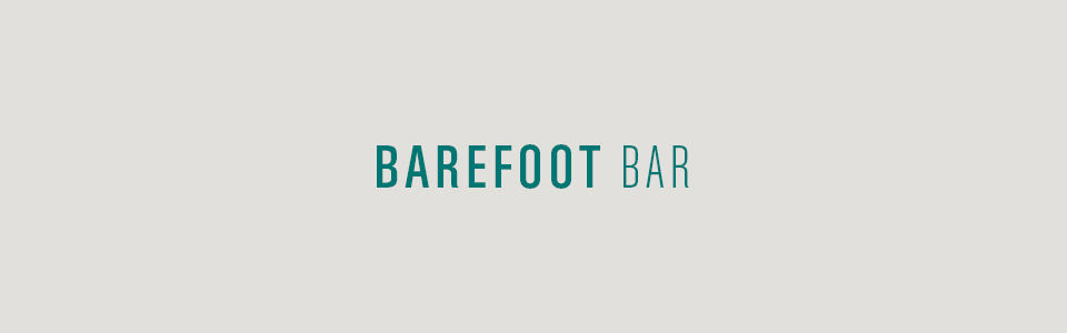 Barefoot bar on tan background