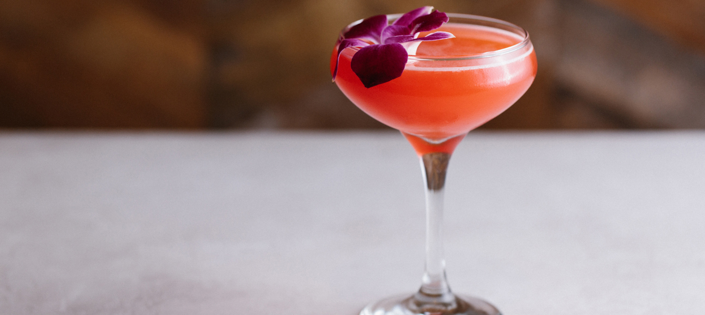 Pink cocktail with flower
