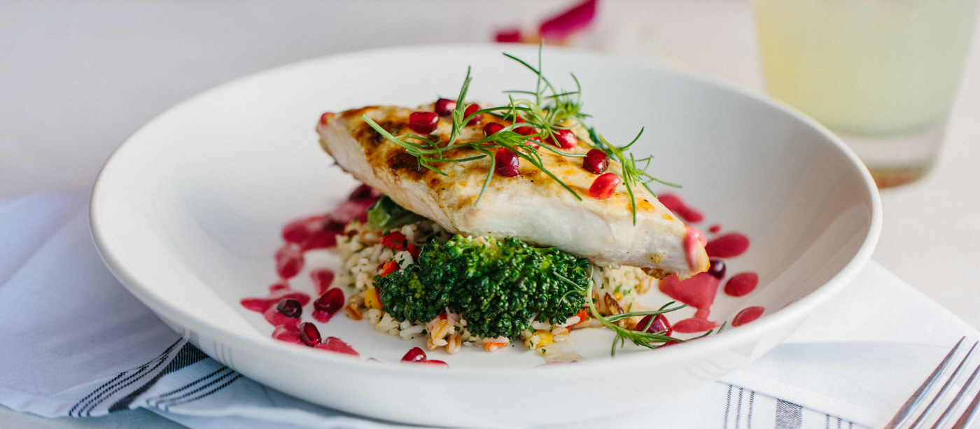 Plated fish on a bed of rice