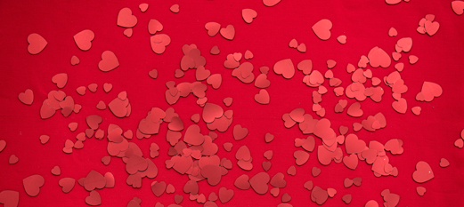 Red background with lighter red hearts randomly placed