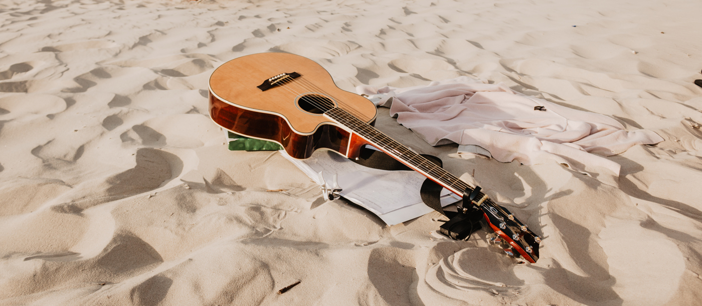 Acoustic guitar on the sand